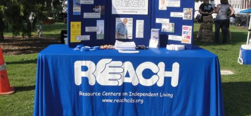 REACH of Denton blue display table on the square in Denton