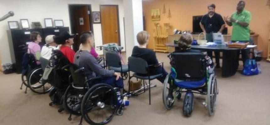 REACH of Fort Worth Consumers in Wheelchairs listening to a Presentation on Home Safety